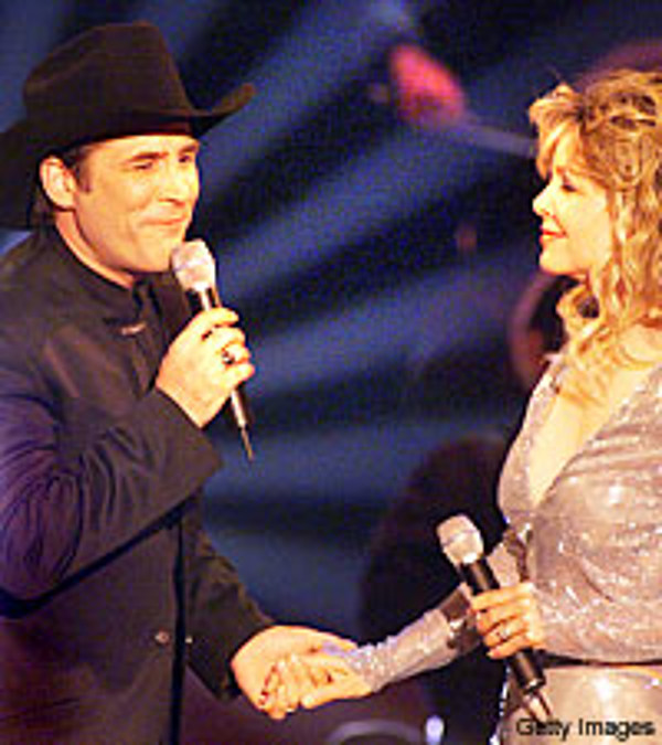 Best country love duets no 1 for Where is clint black and lisa hartman