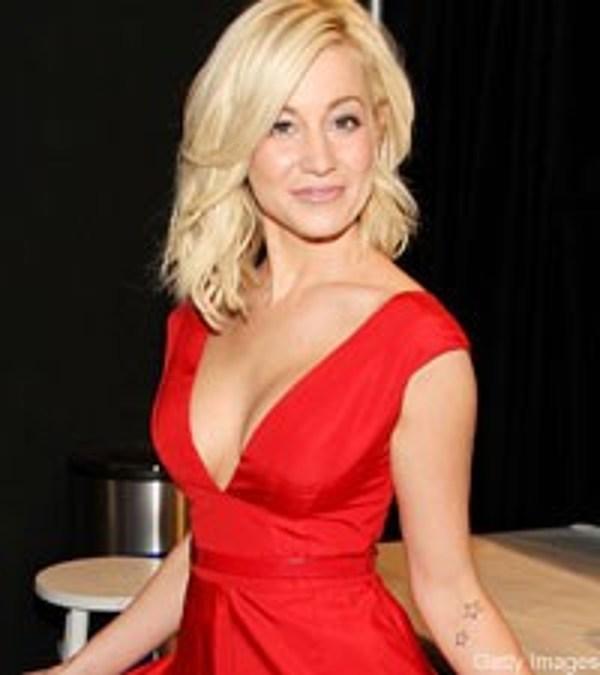 Kellie pickler sports patriotic ink for Miranda lambert tattoo on arm