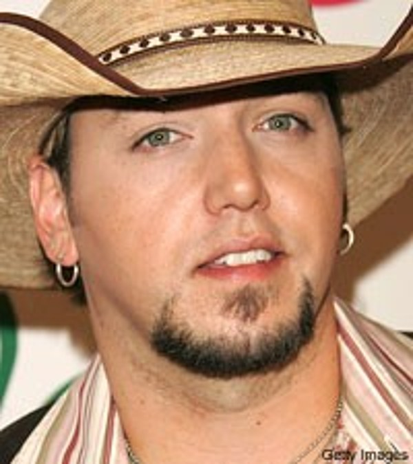 jason aldean welcomes canine royalty