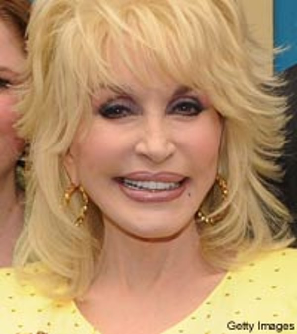 Dolly parton presents donation for nashville flood relief for What is dolly parton s husband s name